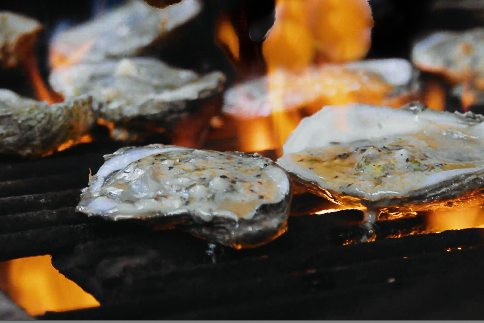 Smoked and flames add flavor to these oysters. (Photo credit: George Graham)