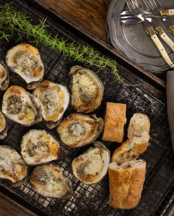 Buttery, garlicky, and cheesy--Louisiana oysters on the half shell are delicious right off the grill. (Photo credit: George Graham)
