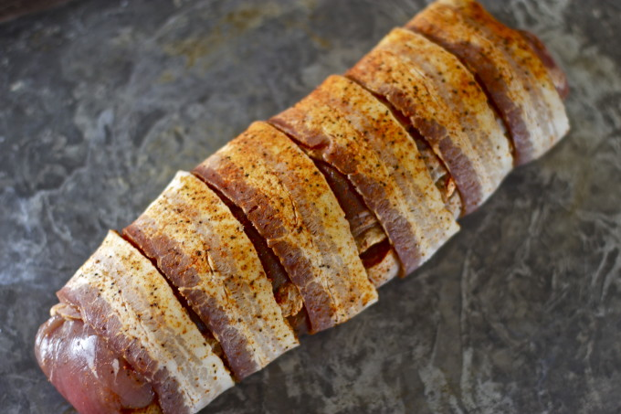 Boudin-Stuffed Pork Tenderloin wrapped in bacon for a creative Cajun recipe.