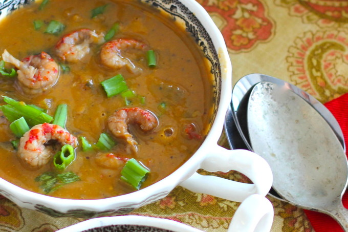 Bowl of Crawfish and Pumpkin Bisque with Caribbean and Cajun recipe ingredients.