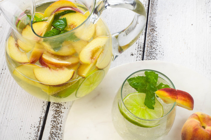 Peach Muscadine Sangria is a Cajun recipe for a great cocktail.