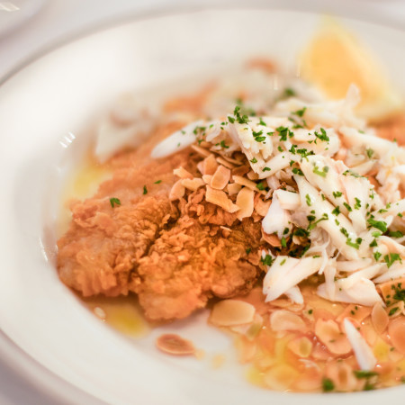 A Galatoire's creation - crispy black drum in a butter lemon sauce studded with almonds and topped with fresh crabmeat. (All photos credit: George Graham)