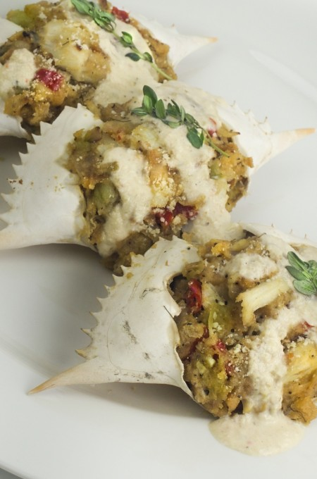 Gulf coast crabmeat is elevated with a herbal cream reduction in this Cajun recipe for Stuffed Crab.