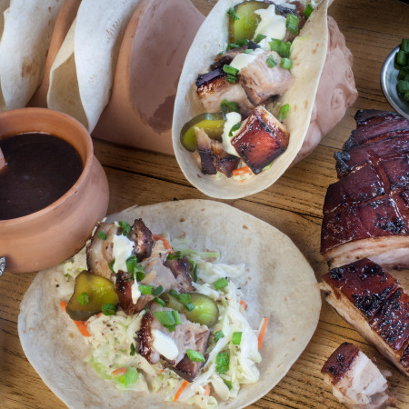 Pork Belly tacos served up tangy and sweet glazed with root beer on a bed of creamy slaw. (All photos credit: George Graham)