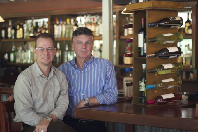 Co-owners Christopher Thames (left) and Leon Steele (right) at the Grand Coteau Bistro bar.