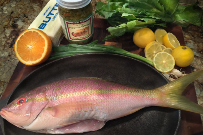 Colorful yellowtail snapper combine with equally colorful ingredients--perfect for a Cajun recipe.