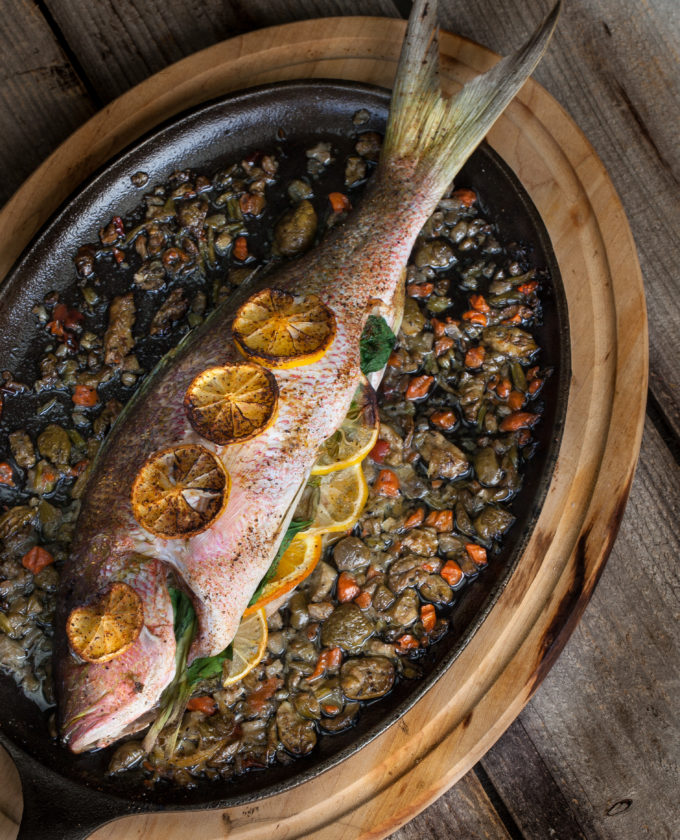 Whole fish cooked on the bone is always sweeter and tastier. Give this Baked Yellowtail Snapper recipe a try.