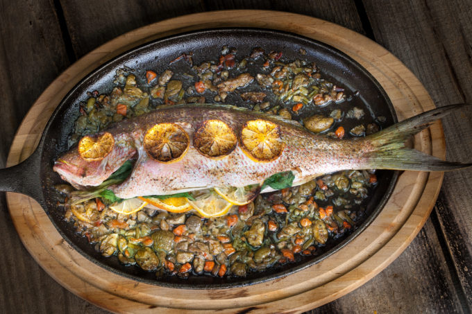 Oven-baked and stuffed with flavor, this Baked Yellowtail Snapper is a classic Cajun recipe. (All photos credit: George Graham)