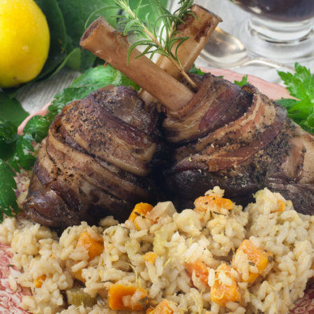 Bacon-wrapped lamb on the bone smoked in pecan wood pairs perfectly with sweet potato risotto. (All photos credit: George Graham)