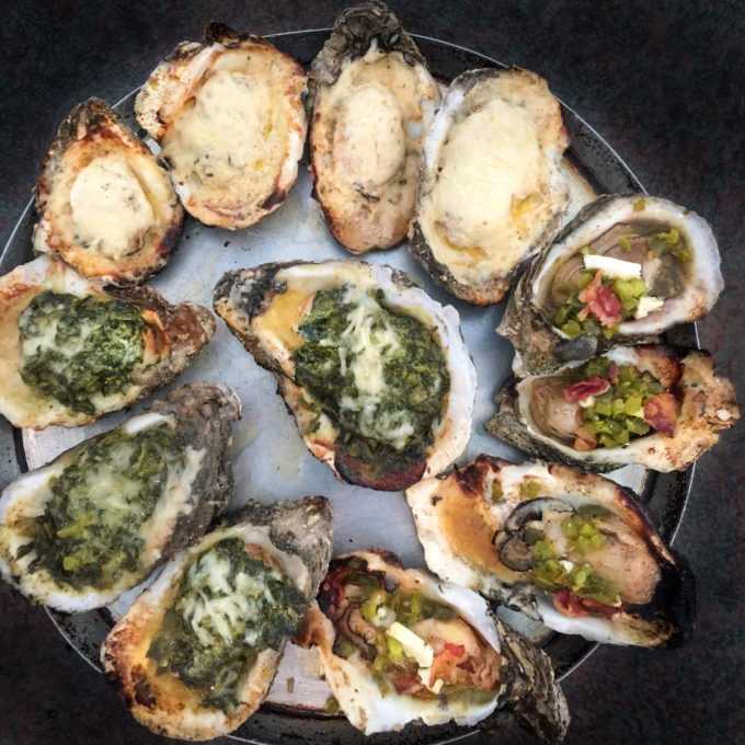 Clockwise from top: Shuck-a-fella, Roughneck, and Rockefeller oysters share the plate.