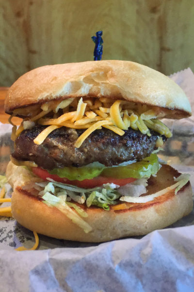 The vertically stacked Little Boy Burger is anything but little. This Cajun recipe is Cajun cooking at its best!