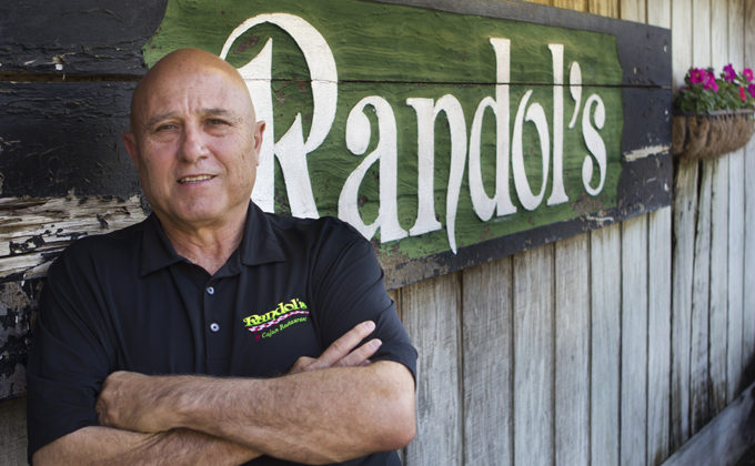 Fran Randol outside his Cajun restaurant in Lafayette, LA. (Photo credit: Ed Lallo)