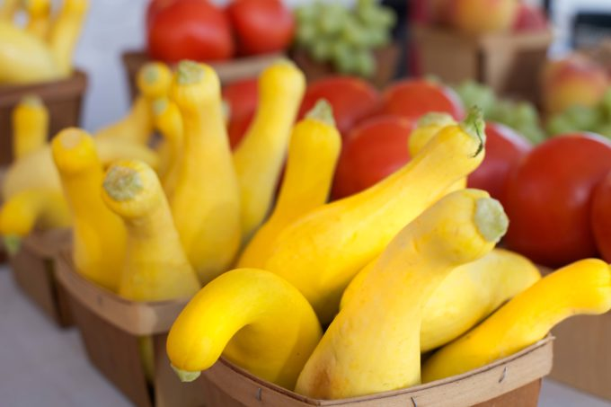Look for the crookneck variety of yellow squash at the local farmers markets.