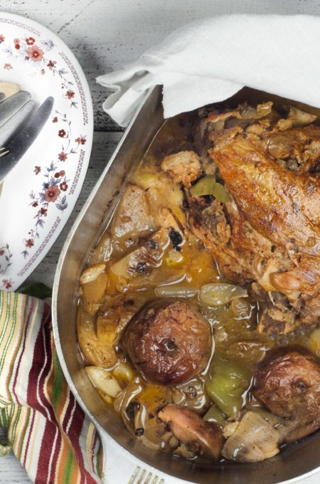 The flavor of apples and fresh aromatics work deliciously with a roast of pork.