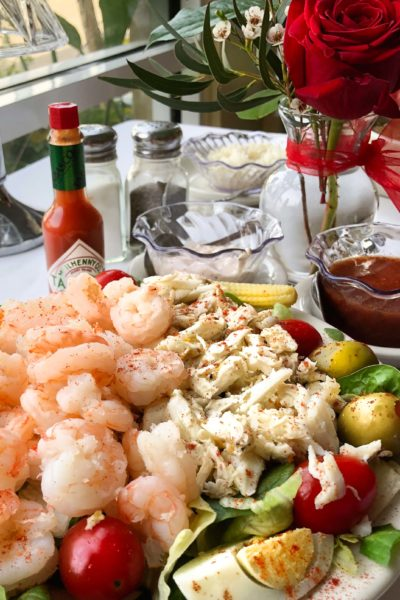 A cold glass of white wine is the perfect pairing for this classic seafood salad.