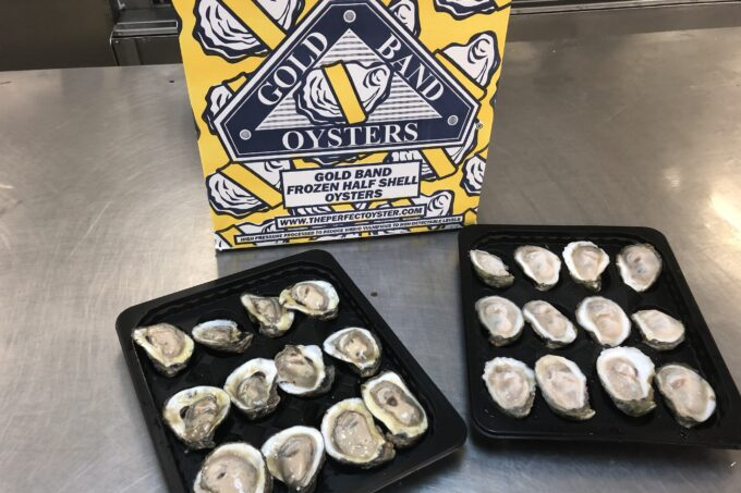 Gold Band flash-frozen oysters on the half-shell are sorted on trays and boxed for shipping. (Photo credit: George Graham)